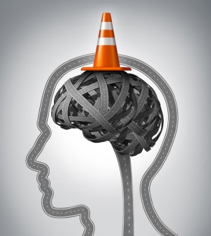 Human brain repair as neurology therapy and memory damage medical concept with an orange traffic cone as a safety hat metaphor on a group of tangled roads in the shape of a human head.