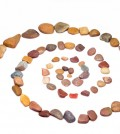 Stone spiral made from the pebbles isolated on the white