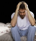 young man unable sleep because of stress of problems