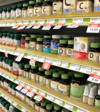 TORONTO, CANADA - MAY 07, 2014: Different types of vitamins and supplements on shelves in a pharmacy in Toronto, Ontario, Canada. According to studies, North America and Asia lead vitamin and supplement usage in the world.