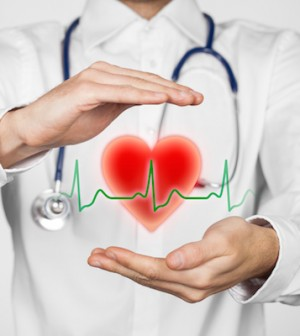 Protect health (healthcare) and heart problems prevention (cardiology) concept. Cardiologist with protective gesture and symbol of heart and ECG heartbeat.