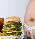 image of obese person next to burgers fries and soda